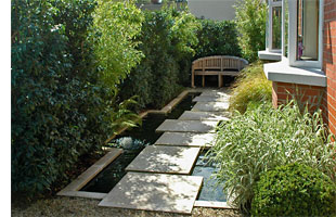 Regular maintenance highlights the strong impact of this courtyard garden.