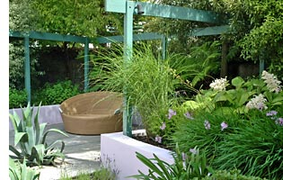 Perennials and ornamental grasses are used to give seasonal interest within the garden plan.