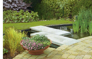 Large patio with wrap-around pond water feature gives the garden plan a contemporary feel.