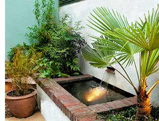 The small water feature design brings light to the courtyard.
